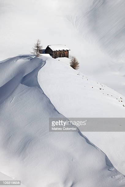 mountain hut in snow - alta badia stock pictures, royalty-free photos & images
