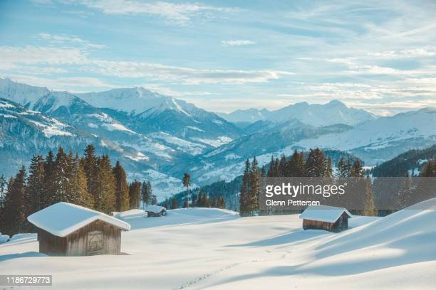 mountain huts in snowy laax, switzerland. - vehicle interior stock pictures, royalty-free photos & images