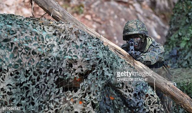 A mountain infantry soldier aims with his gun during an exercise of the mountain infantry brigade 23 of the German Bundeswehr at an exercise area...