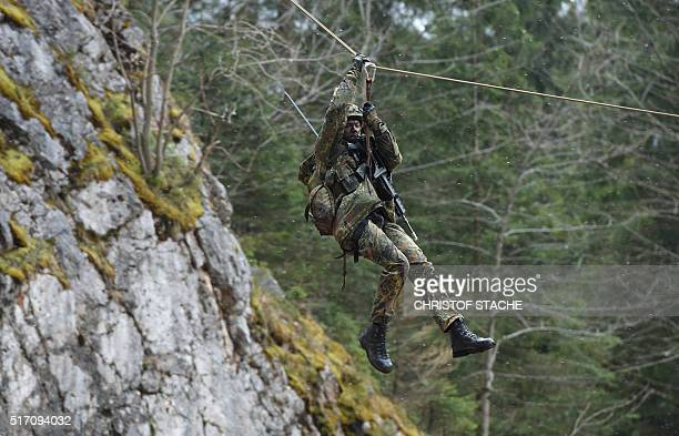A mountain infantry soldier rappels off during an exercise of the mountain infantry brigade 23 of the German Bundeswehr at an exercise area near the...