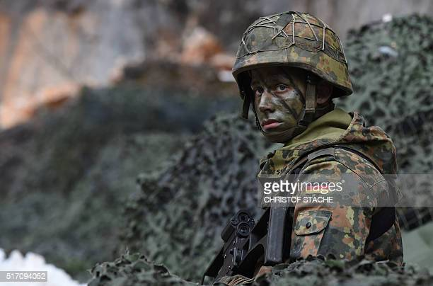 A mountain infantry soldier waits prior an exercise of the mountain infantry brigade 23 of the German Bundeswehr at an exercise area near the...