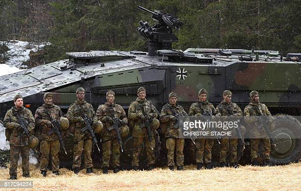Mountain infantry soldiers stand in front of a troops transporter 'Boxer' after an exercise of the mountain infantry brigade 23 of the German...