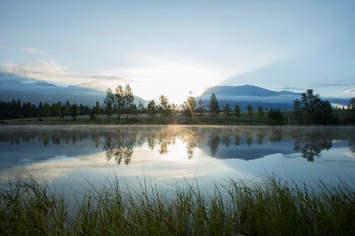 Mountain lake at sunrise 1071099392