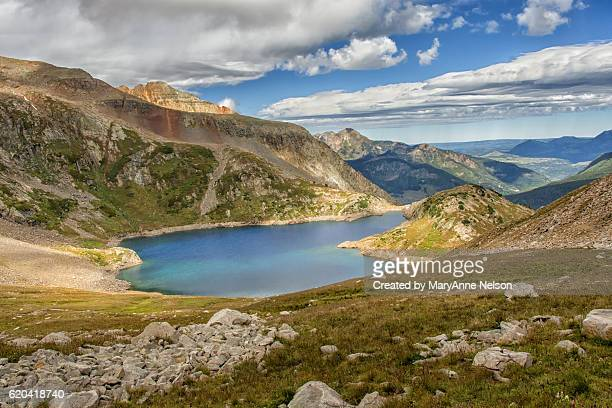 mountain lake in early september - mary lake stock photos and pictures