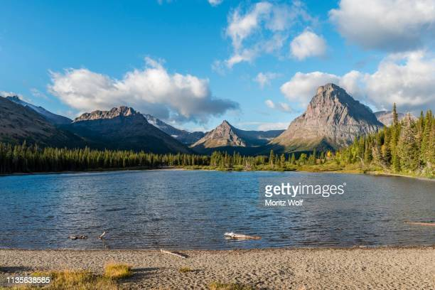 mountain lake two medicine lake in mountain landscape, back sinopah mountain, glacier national park, montana, usa - two medicine lake montana stock photos and pictures