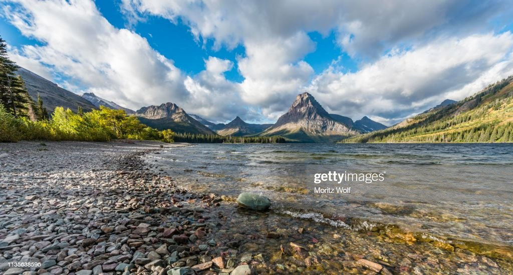 Mountain lake Two Medicine Lake in mountain landscape, back Sinopah Mountain, Glacier National Park, Montana, USA : Stock Photo