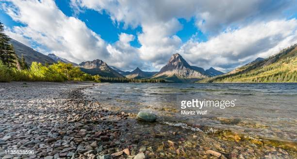 Mountain lake Two Medicine Lake in mountain landscape, back Sinopah Mountain, Glacier National Park, Montana, USA