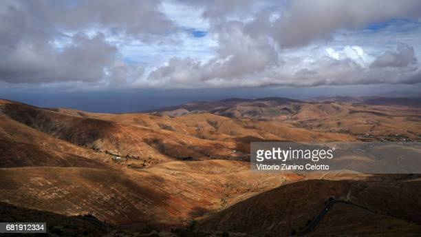 Mountain landscape around the roadway FV 10 between Corralejo and El Cotillo on May 11 2017 in Fuerteventura Spain