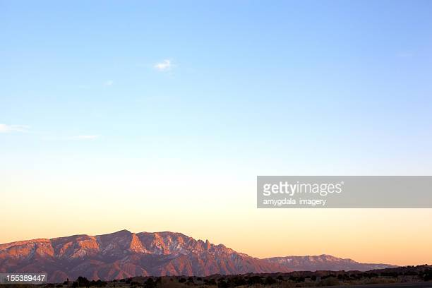 mountain landscape sunset sky - sandia mountains stock photos and pictures