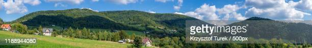 mountain landscape with buildings, limanowa, poland - krzysztof turek stock pictures, royalty-free photos & images