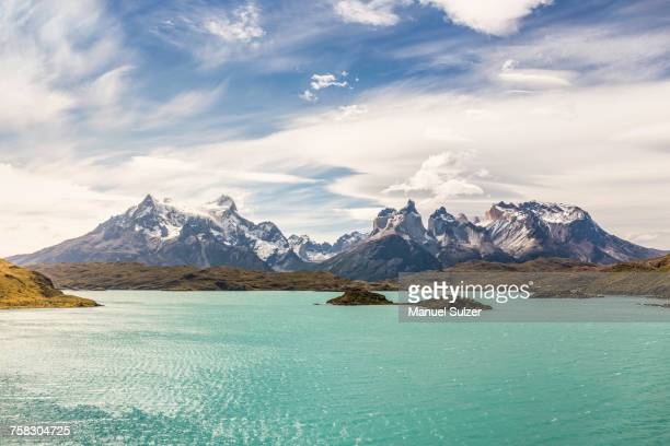 mountain landscape with grey lake, paine grande and cuernos del paine, torres del paine national park, chile - patagonia chile stock photos and pictures