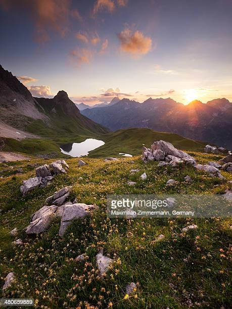 Mountain landscape with  lake at sunset.