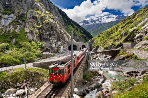Mountain landscape with railway bridge and train, Switzerland