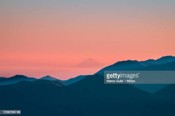 mountain landscape with stromboli volcano behind, viggianello, italy - nature stock pictures, royalty-free photos & images