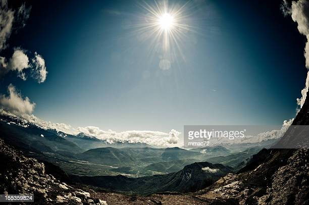Mountain landscape with sun