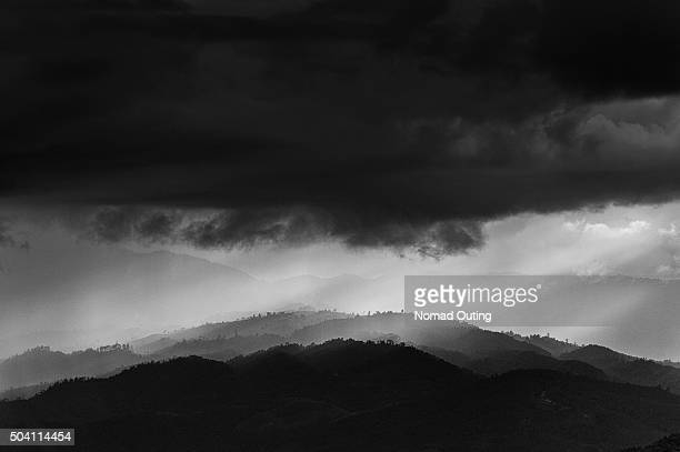 Mountain landscape with sunlight and dramatic cloudy.