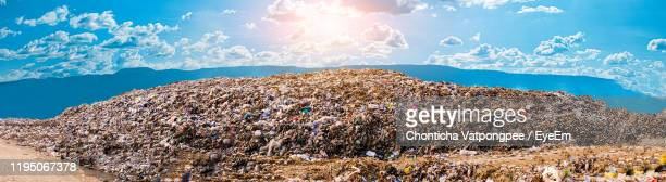 mountain large garbage pile and pollution - landfill stock pictures, royalty-free photos & images