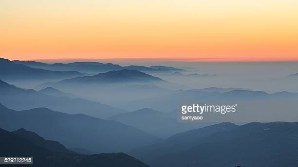 mountain layers after sunset - after stock photos and pictures