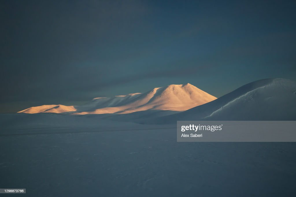 A mountain lit by sunrise. : Stock Photo