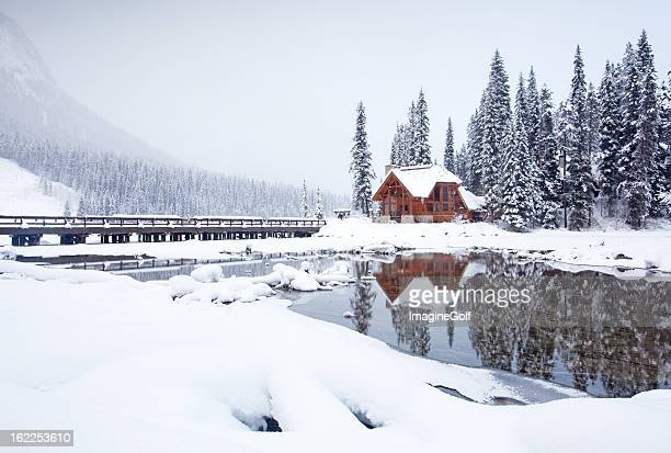 mountain lodge in winter - banff stock photos and pictures