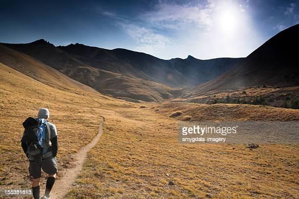 mountain man hiking sunshine landscape