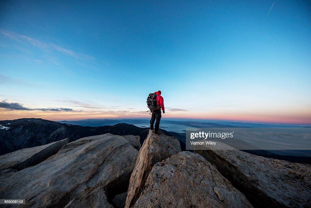 Mountain man on a summit : Stock Photo