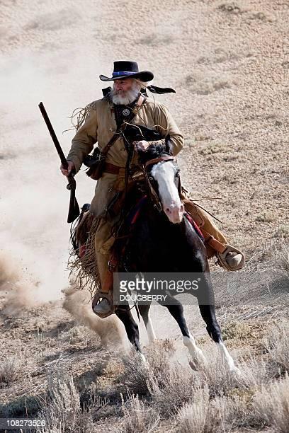 mountain man - cowboy stock photos and pictures