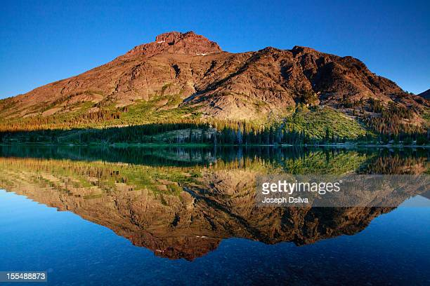 a mountain of a reflection... - two medicine lake montana fotografías e imágenes de stock