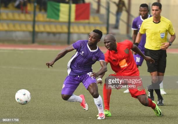 Mountain of Fire and Miracles Ministries football club attacker Onuwa Chukwuka and Djoliba AC Malian club's player vie for the ball during the CAF...