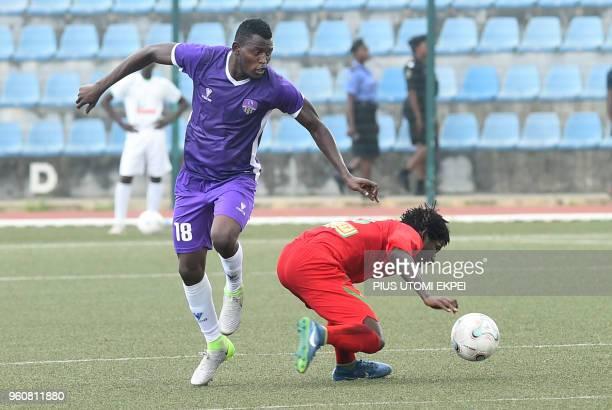 Mountain of Fire and Miracles Ministries football club midfielder Monsuru Bashiru and Djoliba AC Malian club's player vie during the CAF...