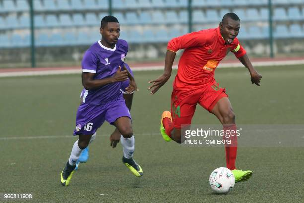 Mountain of Fire and Miracles Ministries football club midfielder Charles Baye and Djoliba AC Malian club's player Seydou Diallo vie during the CAF...