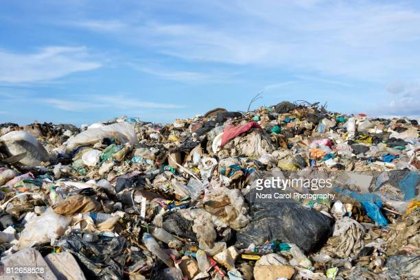 Mountain of garbage at the landfill site with blue sky