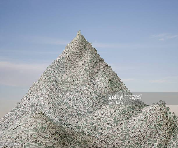 a mountain of money - john lund stock pictures, royalty-free photos & images