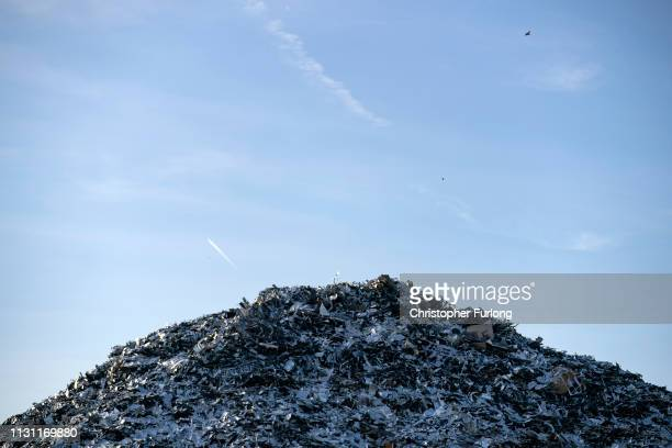 Mountain of scrap metal waits to be shipped for export at Liverpool docks on February 21, 2019 in Liverpool, England. The global price of scrap and...
