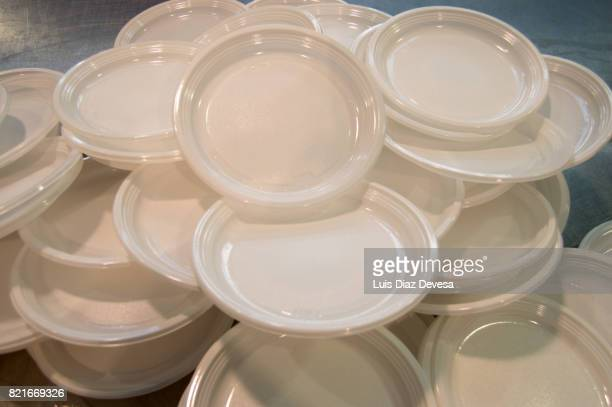mountain of white plates - paper plate stock photos and pictures