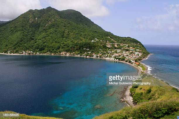 mountain over blue water - dominica stock pictures, royalty-free photos & images