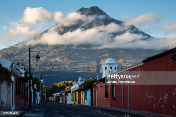 mountain over city street, antigua, sacatepequez, guatemala - guatemala stock pictures, royalty-free photos & images
