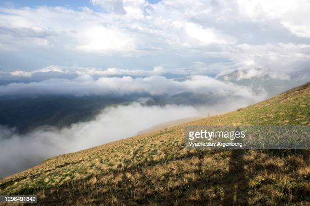 mountain panorama in clouds, adygea, western caucasus - argenberg stock pictures, royalty-free photos & images