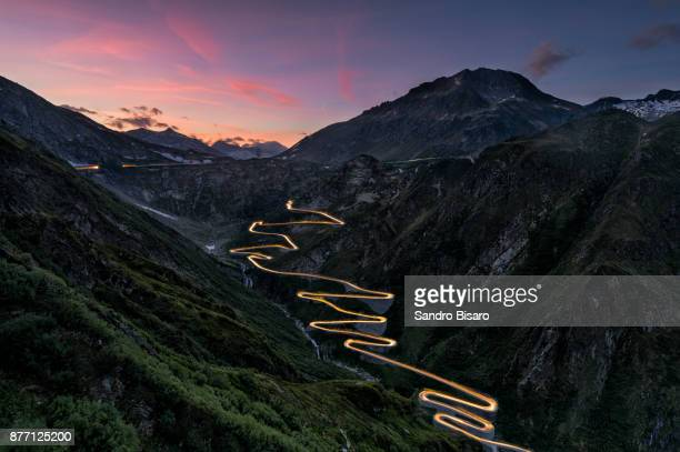 Mountain Pass Road curves at sunset with traffic lights