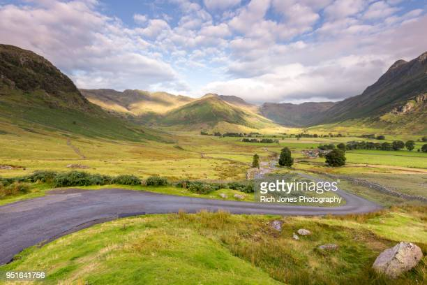 mountain pass road in the english lake district - 谷 ストックフォトと画像