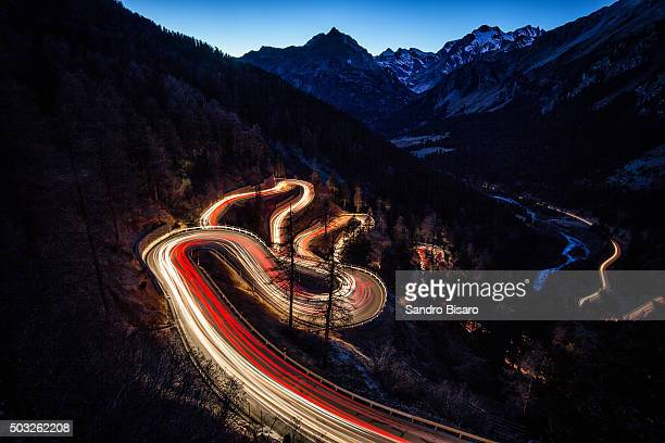 Mountain Pass Road Maloja curves at Night with traffic lights