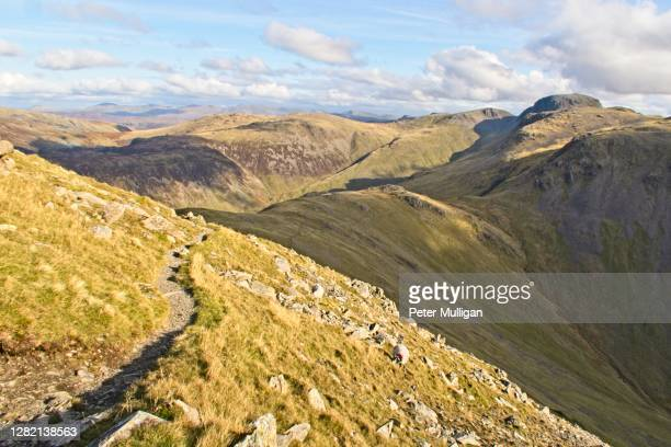 mountain path on the ridge near pillar in the english lake district - footpath stock pictures, royalty-free photos & images