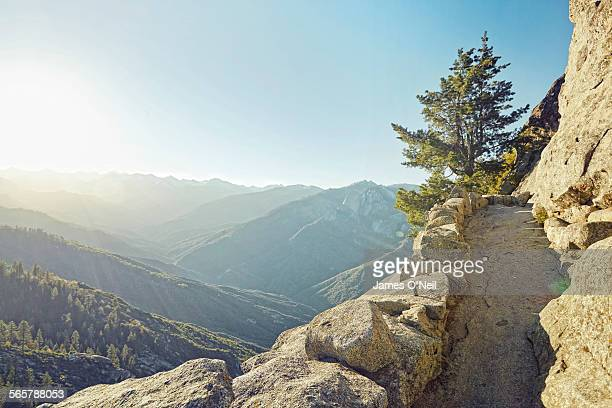 mountain path with sunrise over valley - nature stock pictures, royalty-free photos & images