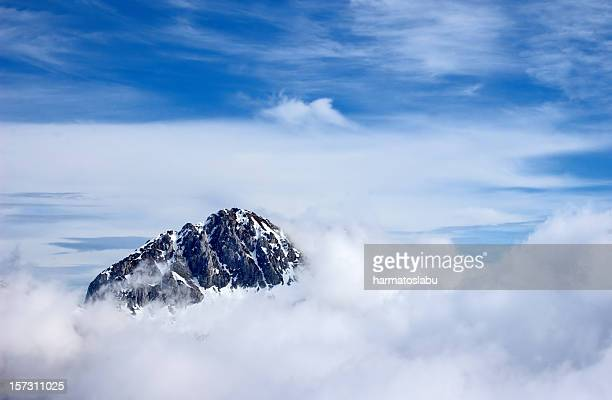 mountain peak above the clouds - reaching stock photos and pictures