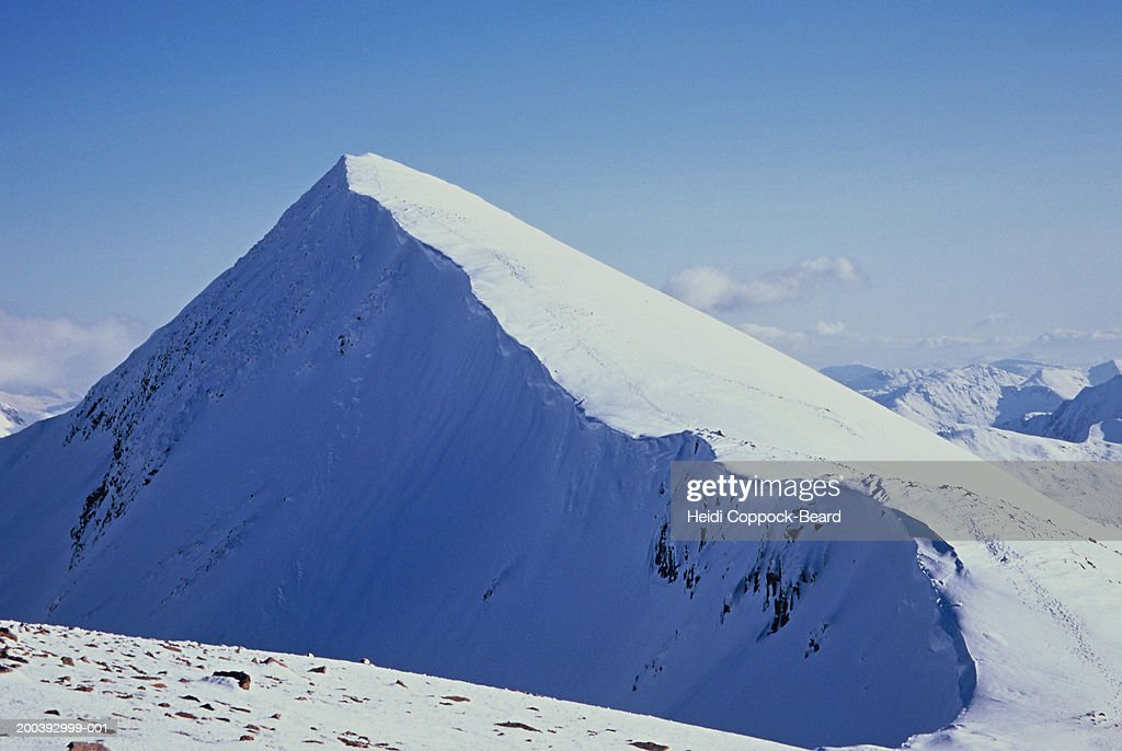 Mountain peak covered in snow : Stock Photo
