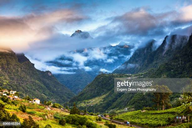 madeira, portugal - juny 2017: mountain peak near boaventura town - madeira stock photos and pictures