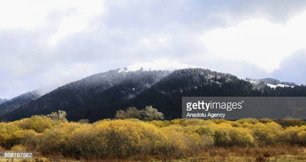 A mountain peak sees first snowfall of season at Lake Abant Nature Park in Bolu Turkey on October 30 2017 Lake Abant is a freshwater lake in Turkey's...