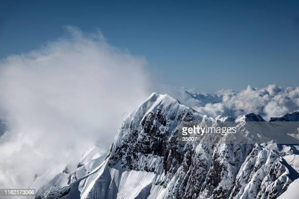 mountain peak, swiss alps, switzerland - snowcapped mountain stock pictures, royalty-free photos & images