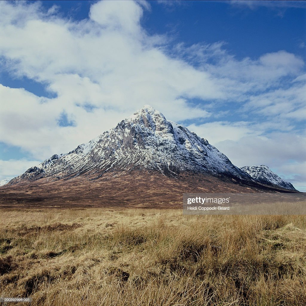 Mountain peak with clouds : Stock Photo