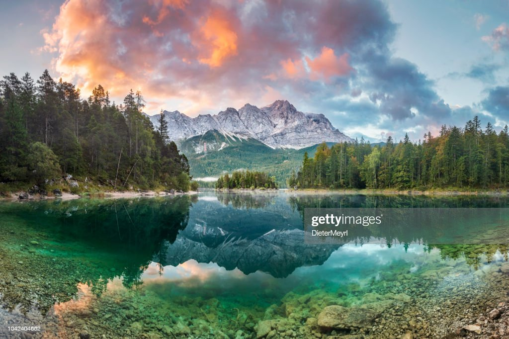Mountain peak Zugspitze Summer day at lake Eibsee near Garmisch Partenkirchen. Bavaria, Germany : Stock Photo